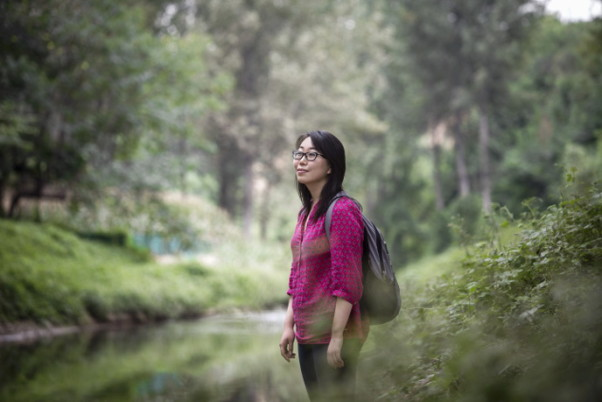 Young Laureate Christine Keung by a polluted river near Xiangjisi village, Xi'an, China.